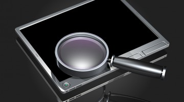 3d illustration of a large magnifying glass hovering over top of a simple touch-screen tablet computer with a glowing Bing logo on the screen